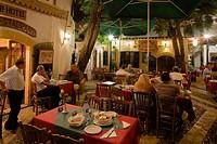 Life in the city, people sitting outside Rimi Restaurant at night enjoying an evening meal, Laiki Geitonia, Lefkosia, Nicosia, Cyprus