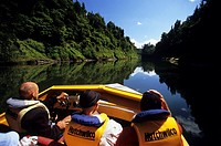People driving a motorboat on the Wanganui River, North Island, New Zealand
