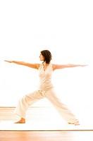 Mid adult woman practising yoga Warrior Pose, yoga studio at Linz, Austria
