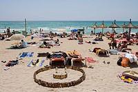 San Miguel Beer Bottle Smile on Beach, El Arenal, Playa de Palma, Mallorca, Balearic Islands, Spain