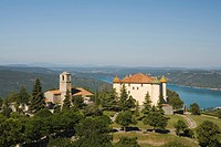 View at castle and church of the village Aiguines in front of the lake Lac de Ste. Croix, Var, Provence, France