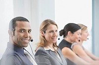 Businesspeople working in headsets