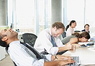 Businesspeople laughing in office