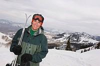 Skier Holding Skis on Mountain