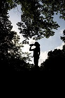 Silhouette of a Jogger relaxing and drinking water