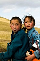 Young Mongolian nomads on their horses