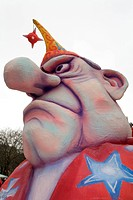 Face of a man with huge nose and mad eyes, caricature made of paper maché, monday before lent parade, Duesseldorf, NRW, Germany