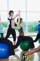 Instructor guiding fitness class