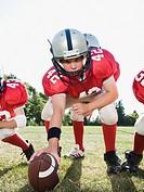 Football center preparing to snap football