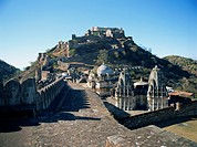 Foreground paved battlements, temples and Badal Mahal Cloud Palace, Kumbalgarh Fort, Rajasthan state, India, Asia