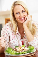Mid Adult Woman Eating A Healthy Meal, Smiling At The Camera
