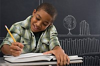 A boy writing in a notebook
