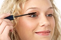 Young Woman Applying Make_Up