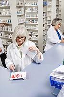 Pharmacists filling prescriptions