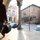 Businessman checks watch heads into historic town center Moncalieri Turin area