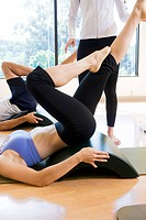 Woman with legs raised in exercise class