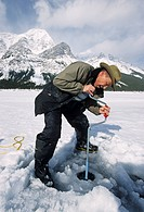 Ice Fishing on the Spray Lake, Banff National Park, Alberta, Canada