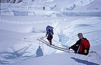 Crossing of a crevasse by ladder, Western Cwm, 6000m Mount Everest, Himalaya, Nepal