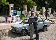 Ukraine Kiev Andrijivskyj road lovers hug them in front of car picture galerie at the road side 2004