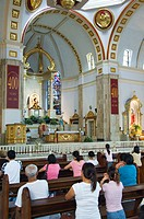 Worshippers in Church of the Black Nazarene, Quaipo District, Manila, Philippines, Southeast Asia, Asia
