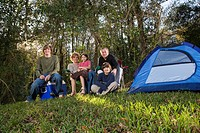 Portrait of family together on camping trip at campsite