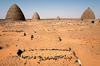 Graves, including beehive graves Tholos tombs, in the desert near the ruins of the medieval city of Old Dongola, Sudan, Africa