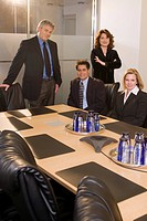 Portrait of multi_ethnic businesspeople in boardroom, looking at camera