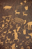 Rock petroglyphs of footprints and animals in the Newspaper Rock State Historical Monument, in Utah, United States of America, North America