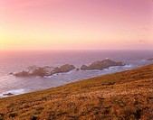 Muckle Flugga and lighthouse, built by Stevenson family, at sunset, most northerly point in Britain, Hermaness Nature Reserve, Unst, Shetland Islands,...