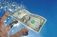 US Dollar bill sinking underwater