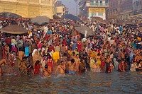Hindu religious morning rituals in the Ganges Ganga River, Makar San Kranti festival, Varanasi Benares, Uttar Pradesh State, India