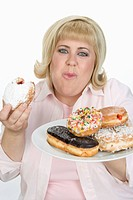 Woman Eating Donuts