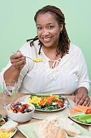 Overweight mid_adult woman having healthy meal