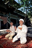 Imam and assistant praying, Central Mosque, Margilan, Uzbekistan, Central Asia, Asia