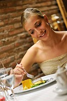 Girl smiling that meal in a restaurant