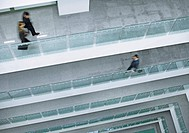 People walking along corridor in an office building