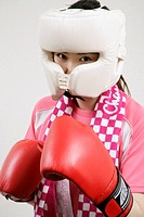 A woman taking a fighting pose