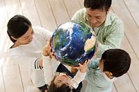 Globe Held by Family