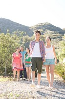 Young people hiking in gravel walk