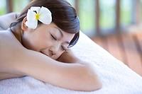 Young woman lying on massage table, Saipan