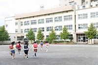 Japanese Students Running At Schoolyard