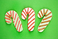 Candy cane sugar cookies with decorative icing.