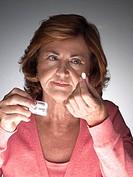 Mature woman taking aspirin