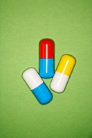 Medical pills on a green background.