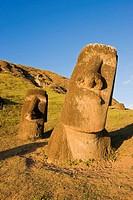 Giant monolithic stone Moai statues at Rano Raraku, Rapa Nui Easter Island, UNESCO World Heritage Site, Chile, South America