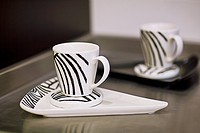 Cups with trays on a kitchen counter