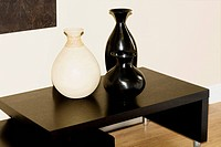 Three vases on a sideboard