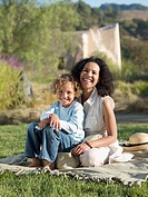 Mother and son sitting in park