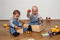 One and one-and-a-half-year-old boys playing