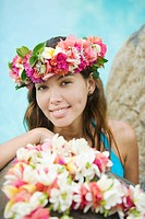 Young woman with flowers in hair in moorea